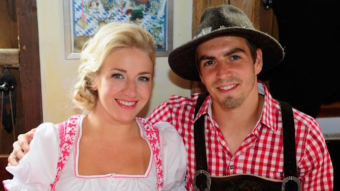 Philipp Lahm, right, of Bayern Munich and his wife Claudia Lahm attend the Oktoberfest beer festival in Munich southern Germany, Sunday, Oct 6, 2013