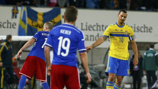 Sweden's Ibrahimovic shakes hand with Liechtenstein's Martin Rechsteiner after their soccer match in Vaduz