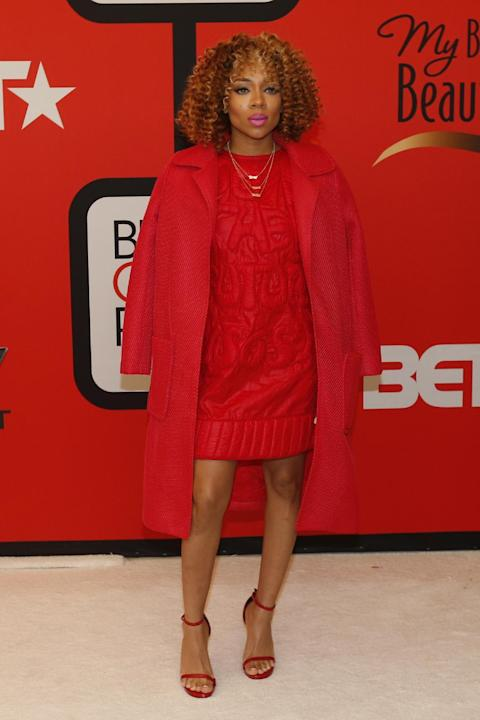 Singer Lil Mama poses for photographers during the red carpet ahead of the Black Girls Rock award ceremony at the New Jersey Performing Arts Center, Saturday, March 28, 2015, in Newark, N.J. (AP Photo