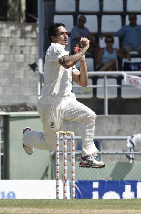 Australia bowler Mitchell Johnson bowls during the opening day of their first cricket Test match against West Indies in Roseau, Wednesday, June 3, 2015. (AP Photo/Arnulfo Franco)
