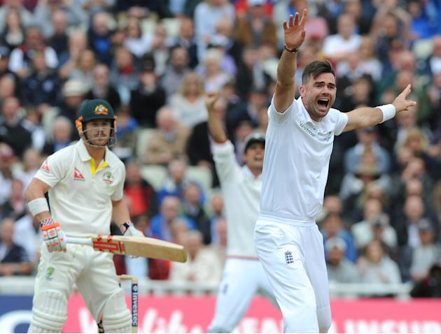 England's James Anderson, right, celebrates after trapping Australia's David Warner, left, LBW for 2 runs during day one of the third Ashes Test cricket match, at Edgbaston, Birmingham, England, Wedne