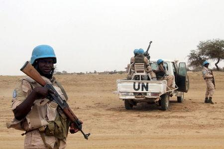 UN peacekeepers stand guard in the northern town of Kouroume