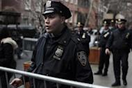 Police officers stand outside the apartment where actor Philip Seymour Hoffman was found dead in Manhattan, New York February 2, 2014. REUTERS/John Taggart