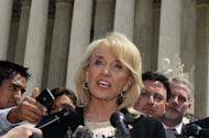 Arizona Governor Jan Brewer speaks to the media after arguments at the U.S. Supreme Court on her state's controversial immigration law