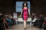 A plus-size model wearing clothes from Simply Be walks down the catwalk during Official British Plus-Size Fashion Weekend in east London on February 16, 2013. This weekend, an alternative to London Fashion Week celebrated the larger lady and all her curves
