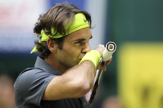 Swiss  Roger Federer reacts during his match against Germany's  Tommy Haas  at the Gerry Weber Open ATP tennis tournament final  in Halle, western Germany, Sunday June 17, 2012.  Wild card Tommy Haas