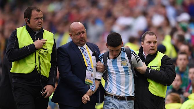 Pitch invader is removed by security