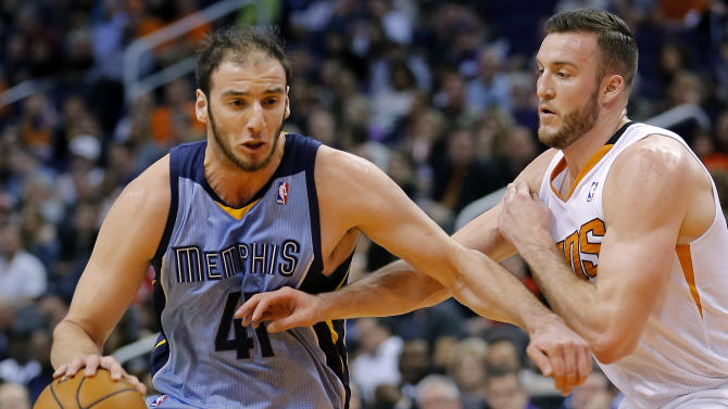 Memphis Grizzlies' Kosta Koufos (41) drives against Phoenix Suns' Miles Plumlee during the first half of an NBA basketball game on Thursday, Jan. 2, 2014, in Phoenix