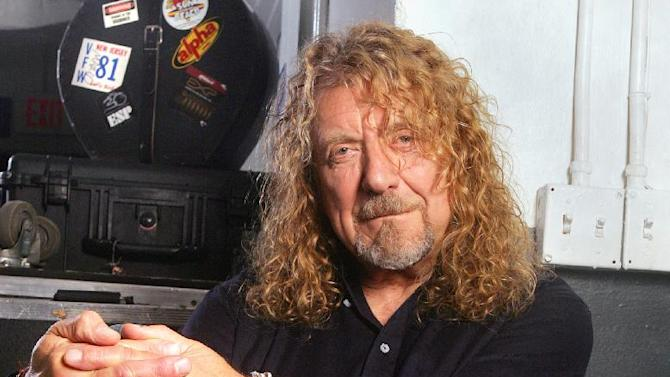 "FILE - This July 30, 2010 file photo shows singer Robert Plant posing at Bayfront Amphitheatre in Miami. Plant will headline at the Sunflower River Blues and Gospel Festival in Clarksdale, Miss. The festival runs Friday through Sunday and will also include performances by multiple Grammy-nominated bluesman Charlie ""Memphis Charlie"" Musselwhite and blues great Bobby Rush.  (AP Photo/Carlo Allegri, file)"