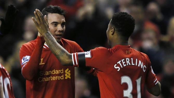 Liverpool's Aspas celebrates his goal with teammate Sterling during their FA Cup third round soccer match against Oldham Athletic at Anfield in Liverpool