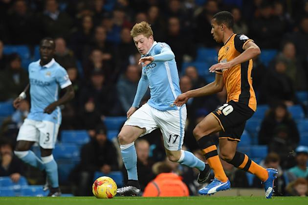 Manchester City's midfielder Kevin De Bruyne (C) is tracked by Hull City's defender Isaac Hayden during an English League Cup quarter-final football match at the Etihad Stadium on December 1,