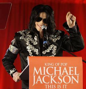 """FILE - In this March 5, 2009 file photo, Michael Jackson announces several concerts at the London O2 Arena in July, at a press conference at the London O2 Arena. An AEG Live accounting executive testified Monday, May 20, 2013, in a Los Angeles courtroom that the company spent $24 million on preparations for Jackson's ill-fated """"This Is It"""" shows, however never paid the singer's personal doctor convicted of involuntary manslaughter because a fully-signed agreement was never obtained.  (AP Photo/Joel Ryan, file)"""