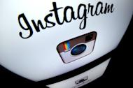 The Instagram logo is displayed on a tablet on December 20, 2012 in Paris. Instagram on Thursday tried to calm a user rebellion by nixing a change that would have given the Facebook-owned mobile photo sharing service unfettered rights to people's pictures