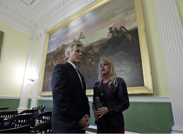Outgoing Virginia Gov. Bob McDonnell and his wife, Maureen, wait in the old Senate Chambers prior to the inauguration of Virginia Governor Terry McAuliffe at the Capitol in Richmond, Va., Saturday, Ja
