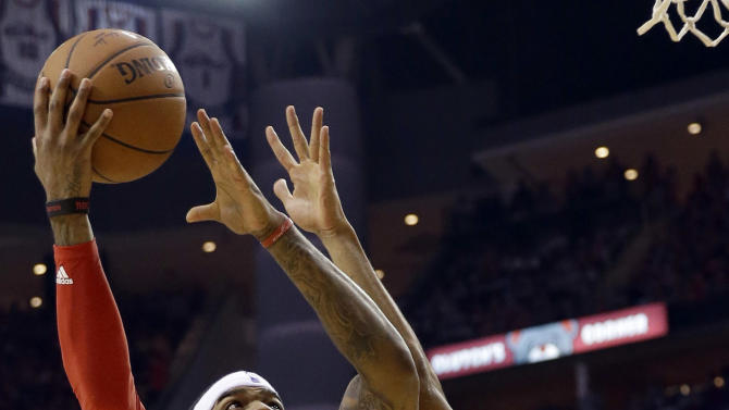 Houston Rockets forward Josh Smith (5) shoots over Golden State Warriors guard Shaun Livingston (34) during the second half in Game 3 of the NBA basketball Western Conference finals Saturday, May 23, 2015, in Houston. (AP Photo/David J. Phillip)