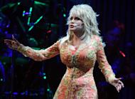 """KNOXVILLE, TN - JULY 17: Singer/Songwriter Dolly Parton performs during the """"Better Day"""" world tour opener at the Thompson-Boling Arena on July 17, 2011 in Knoxville, Tennessee. (Photo by Rick Diamond/Getty Images)"""