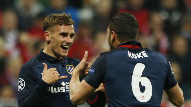 Antoine Griezmann celebrates scoring the first goal for Atletico Madrid with Koke