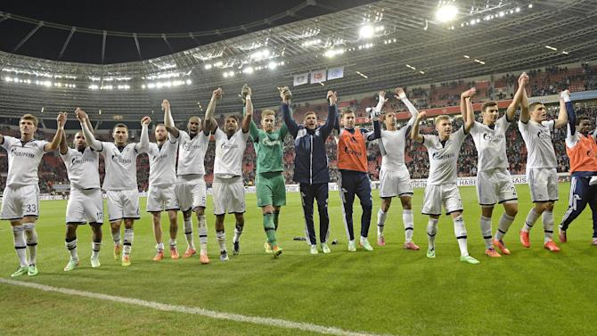 Schalke's team celebrates after winning the German Bundesliga soccer match between Bayer Leverkusen and FC Schalke 04 in Leverkusen,  Germany, Saturday, Feb. 15, 2014. Leverkusen was defeated by Schalke 2-1