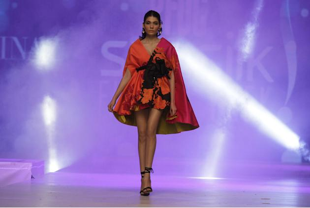 FILE - In this Tuesday, April 21, 2015 file photo, a model presents creations by Pakistani designer Sana Safinaz on the last day of PFDC Sunsilk Fashion Week Spring/Summer 2015 in Lahore, Pakistan. (A