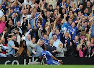 Ashley Cole celebrates his goal against Stoke