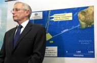 John Young, general manager of the emergency response division of the Australian Maritime Safety Authority (AMSA), answers a question as he stands in front of a diagram showing the search area for Malaysia Airlines Flight MH370 in the southern Indian Ocean, during a briefing in Canberra March 20, 2014. REUTERS/Sean Davey