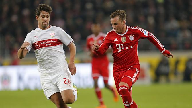 Stuttgart's Rani Khedira, left, and Bayern's Mario Goetze challenge for the ball during a German first soccer division Bundesliga match between VfB Stuttgart and FC Bayern Munich in Stuttgart, Germany, Wednesday, Jan. 29, 2014