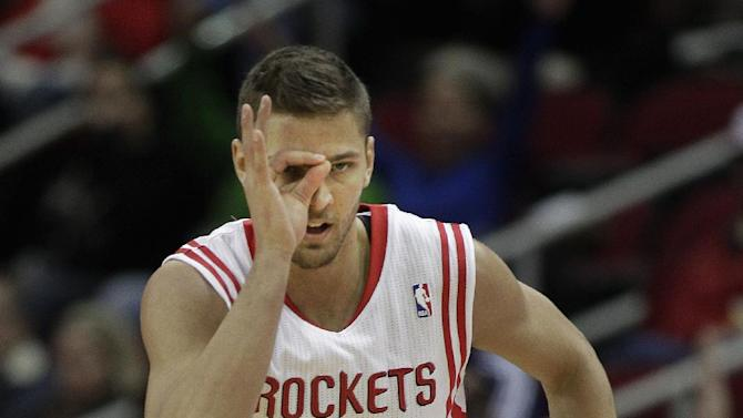 Houston Rockets small forward Chandler Parsons (25) signals after making a three-pointer against the Orlando Magic during the first quarter of an NBA basketball game on Sunday, Dec. 8, 2013, in Houston