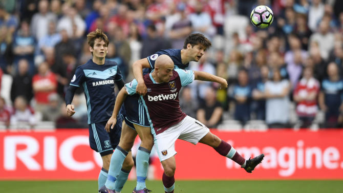 Middlesbrough's George Friend in action with West Ham United's Gokhan Tore