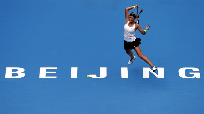 Azarenka of Belarus hits a return to Cornet of France during their first round match at the China Open tennis tournament in Beijing