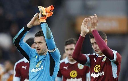 Burnley's Matthew Lowton and Tom Heaton (L) applaud fans after the game