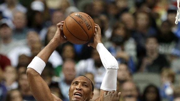 Dallas Mavericks' Shawn Marion (0) comes down with a defensive rebound over Memphis Grizzlies' Zach Randolph (50) in the second half of an NBA basketball game Saturday, Nov. 2, 2013, in Dallas. Marion contributed 21-points in the 111-99 Mavericks win