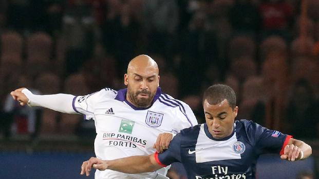 PSG's Lucas, right, challenges for the ball with Anderlecht's Anthony Vanden Borre   during their Champions League group C soccer match against Paris Saint Germain in Paris, France, Tuesday, Nov. 5, 2013. The match ended in a 1-1 draw