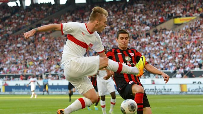 Stuttgart's Alexandru Maxim, left, challenges for the ball with Frankfurt's Johannes Flum during the German Bundesliga soccer  match between VfB Stuttgart and Eintracht Frankfurt at Mercedes-Benz Arena in Stuttgart,Germany,  Sunday Sept. 22, 2013