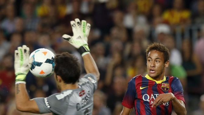 Barcelona's Neymar tries to score against Real Sociedad's goalkeeper Bravo during their Spanish First division soccer league match at Camp Nou stadium in Barcelona