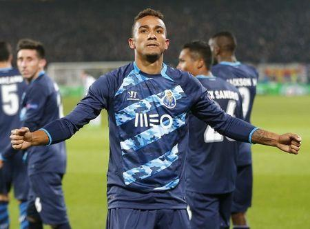 Porto's Danilo celebrates after scoring a penalty during their Champions League round of 16 first leg soccer match against FC Basel in Basel