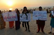 Indian members of NGO 'Aastha' hold placards during a protest in Mumbai on December 27, 2012, for better safety for women following the rape of a student in the Indian capital. An Indian gang-rape victim died Saturday, the hospital treating her in Singapore said, after suffering severe organ failure in an attack that has sparked widespread street protests.