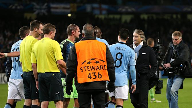 Roberto Mancini, right, was annoyed with some of referee Peter Rasmussen's decisions on Tuesday night