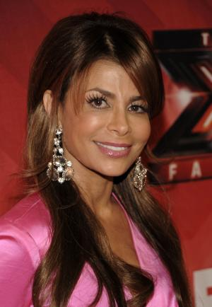 "FILE - In this Dec. 22, 2011 file photo, singer Paula Abdul poses on the red carpet at The X Factor Finale show in Los Angeles. Abdul said she's leaving ""The X Factor"" after one season as judge. (AP Photo/Dan Steinberg, file)"