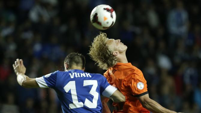 Netherlands' Kuyt fights for the ball with Estonia's Vunk during their World Cup 2014 group D qualifying soccer match in Tallinn
