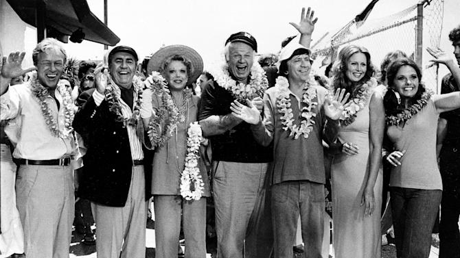 """FILE - This Oct. 2, 1978 file photo shows the cast of """"Gilligan's Island,"""" from left, Russell Johnson, as the professor; Jim Backus as Thurston Howell III; Natalie Schafer, as Mrs. Howell III; Alan Hale Jr., as the skipper; Bob Denver, as Gilligan; Judith Baldwin replacing original cast member Tina Louise, as Ginger, and Dawn Wells, as Mary Ann, posing during filming of a two-hour reunion show, """"The Return from Gilligan's Island,"""" in Los Angeles. Johnson died Thursday, Jan. 16, 2014, at his home in Washington State of natural causes. He was 89. (AP Photo/Wally Fong, File)"""