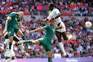 Senegal's forward Moussa Konate (R) challenges Mexico's midfielder Jorge Enriquez (L) and defender Darvin Chavez (C) for the ball in their Olympic quarter-final at Wembley Stadium in London. Mexico won 4-2