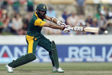 South Africa's Hashim Amla hits a boundary during the Cricket World Cup match against Ireland at Manuka Oval in Canberra