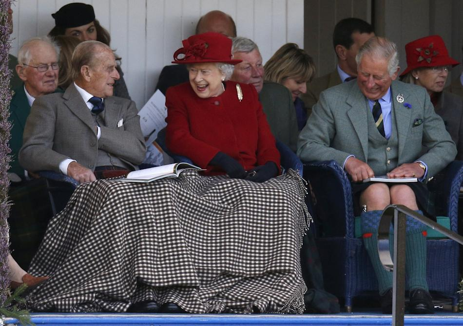 Britain's Queen Elizabeth, Prince Philip and Prince Charles watch the sack race at the annual Braemar Highland Gathering in Braemar, Scotland