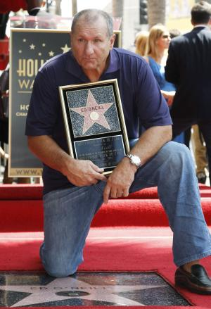 "Actor Ed O'Neill poses for photographers after receiving a star of the Hollywood Walk of Fame in Los Angeles, Tuesday, Aug. 30, 2011.  O'Neill currently stars on the television show ""Modern Family"". (AP Photo/Matt Sayles)"