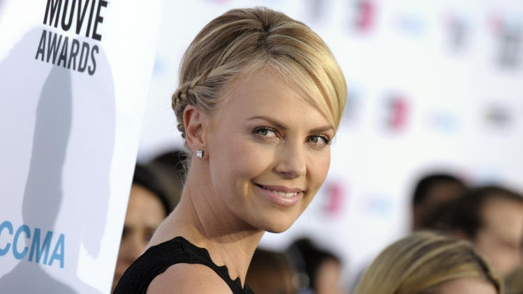 Charlize Theron arrives at the 17th Annual Critics' Choice Movie Awards on Thursday, Jan. 12, 2012 in Los Angeles. (AP Photo/Dan Steinberg)
