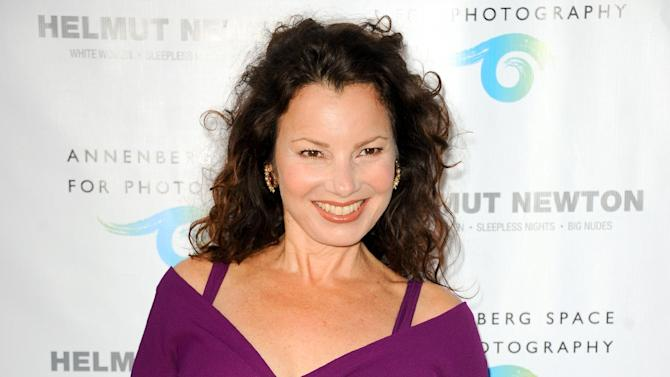 "FILE - This June 27, 2013 file photo shows actress Fran Drescher at the ""Helmut Newton: White Women - Sleepless Nights - Big Nudes "" exhibit opening in Los Angeles. Drescher will make her Broadway debut in the show Feb. 4 playing Cinderella's stepmother in ""Rodgers & Hammerstein's Cinderella."" Drescher's 10-week run ends April 13. (Photo by Richard Shotwell/Invision/AP, File)"
