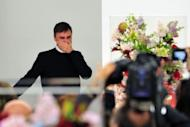 Belgian designer Raf Simons cries at the end of the Jil Sander Fall-winter 2012-2013 collection on February 25. Paris Fashion Week kicked off on Tuesday with the in-crowd abuzz at the prospect of style icon Hedi Slimane designing for Yves Saint Laurent, and rumours putting a newly-free Simons in the wings at Dior