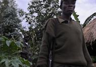 Maimai rebels guard their base in Buhunga, near Minova. Congolese rebels on Sunday rejected demands by regional governments to pull out of the eastern city of Goma to allow for peace talks aimed at preventing a wider conflict and halting a spiralling humanitarian catastrophe.
