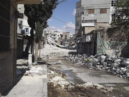 Buildings damaged by the government army, according to the opposition, are seen at Bab Dreeb in Homs