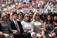 Wife of Republican presidential candidate Mitt Romney, Ann Romney (2R) listens as Mitt Romney delivers the commencement address at Liberty University on May 12, 2012 in Lynchburg, Virginia. Romney, wooing social conservatives, adamantly rejected same-sex marriage Saturday and trumpeted his belief in Christian values and the family